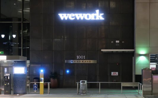 Wework illuminating Front Lit Channel Letters on Woodward Building 1001