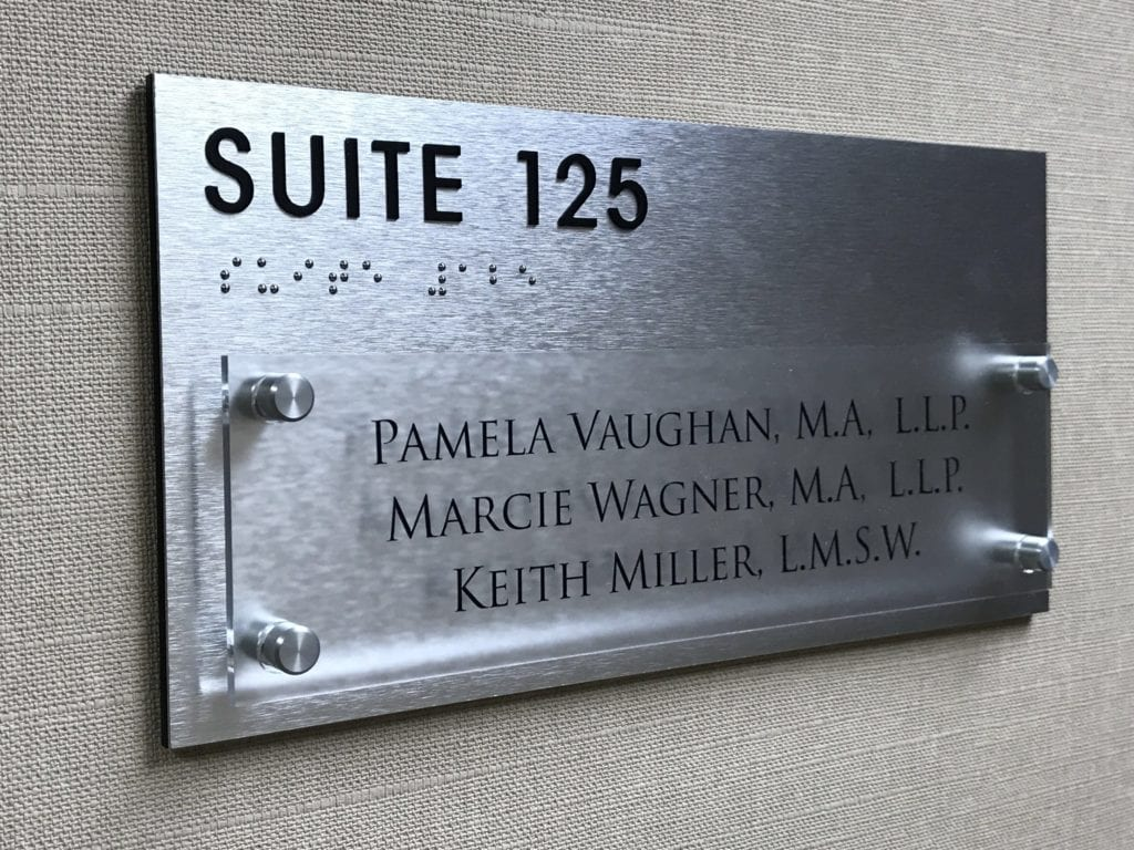 "BRT PROPERTIES "" suite 125"" Stand off glass panels with names"