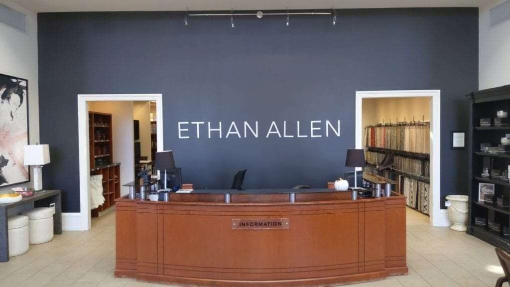 Ethan Allen Interior wall sign logo letters aluminum metal information reception desk