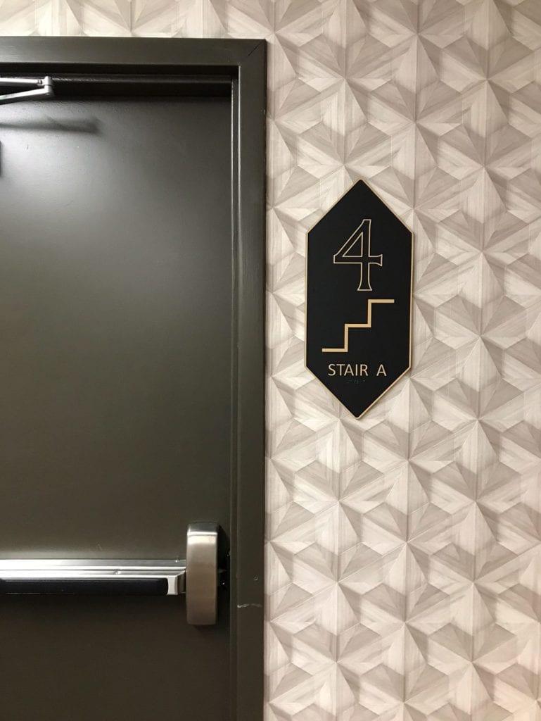 "Building Interior Wayfinding Sign level floor identifier ""4 stair A"""