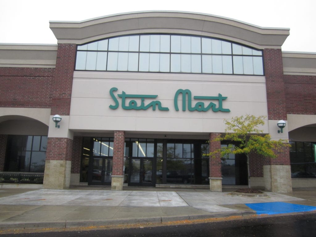 STEIN MART Custom shaped logo channel letters flush moutned dimensional