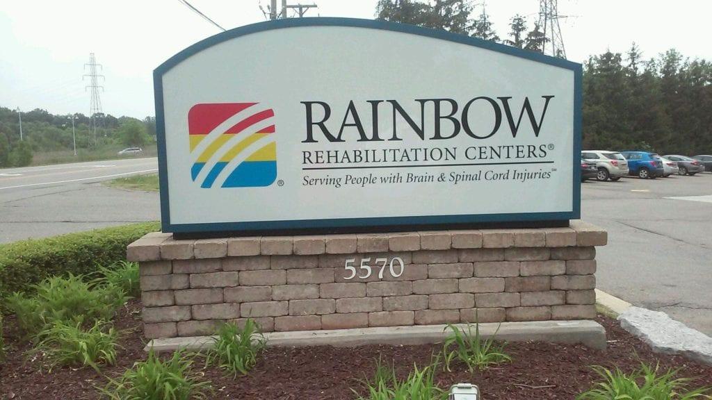 Rainbow Rehebiliatation Centers Monument Exterior Sign Brick Back Custom Shaped