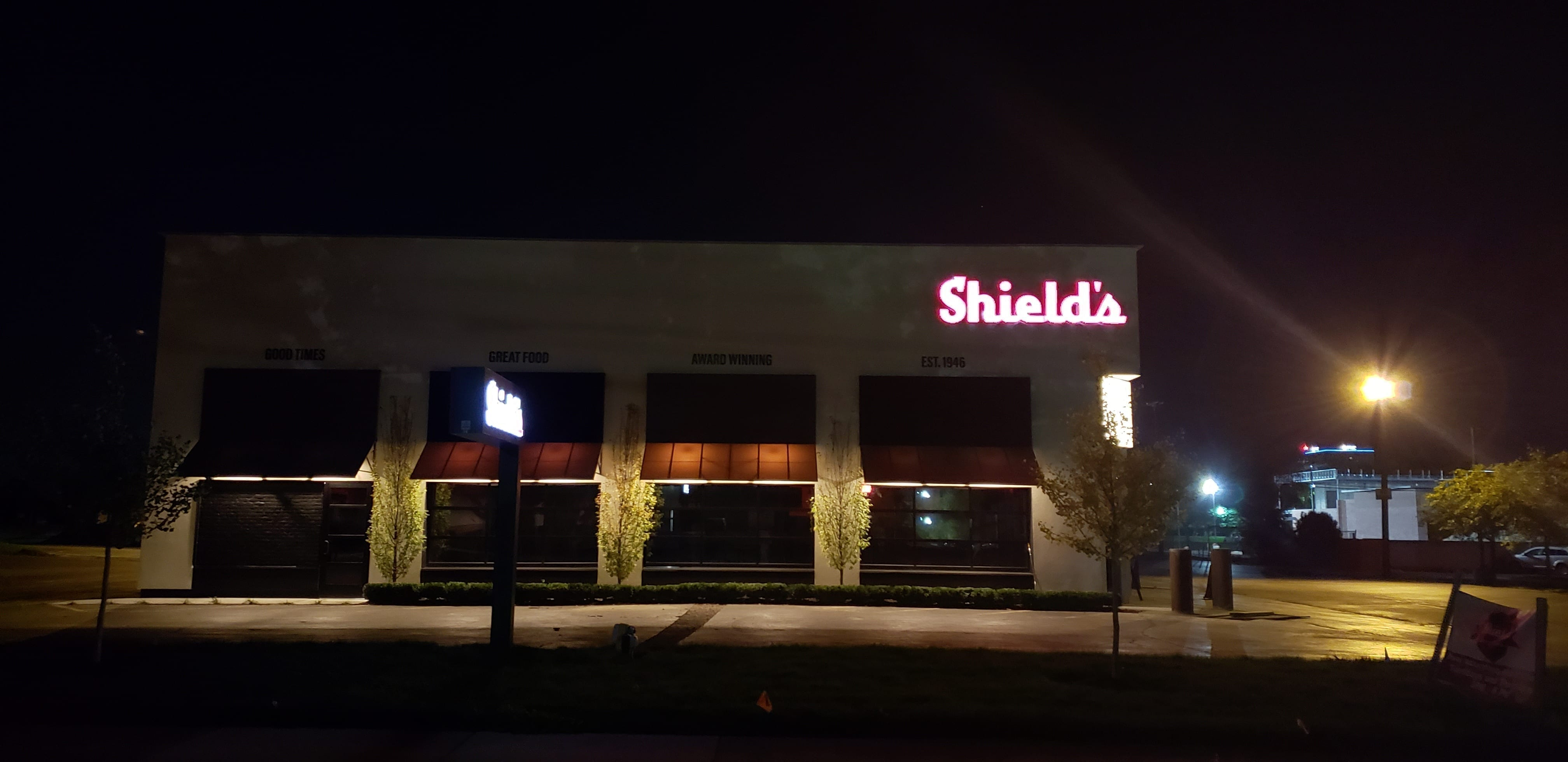 Shield's channel letter illuminated building sign in red