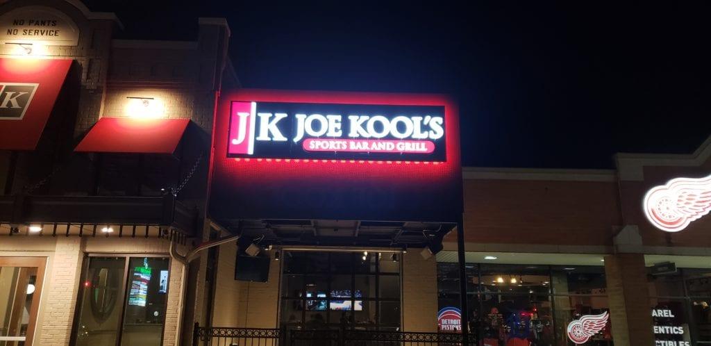 Joe Kools Sports Bar and Grill Halo Lit illuminating sign at night