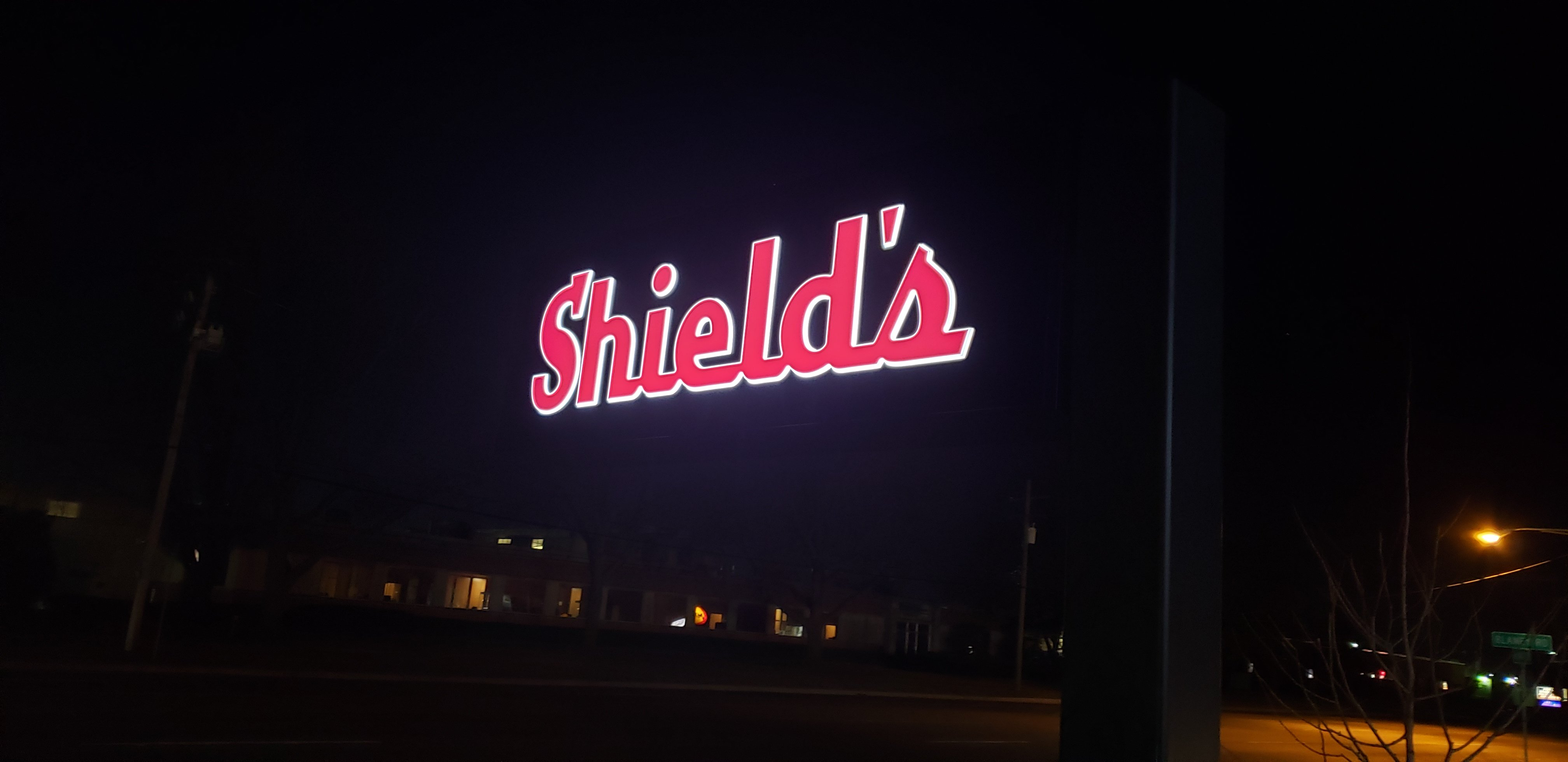 Shield's Front and Halo lit Illuminating Sign at night