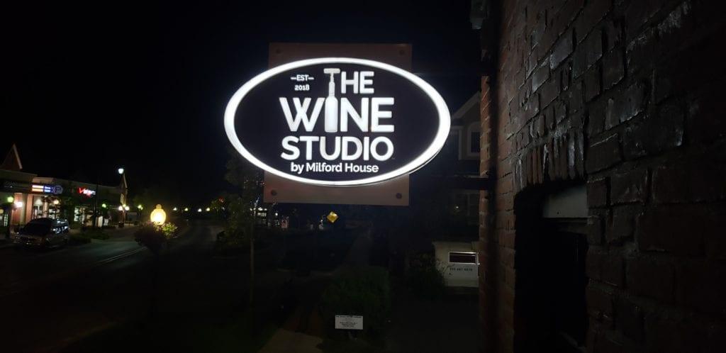 The Wine Studio Illuminating blade sign push thru