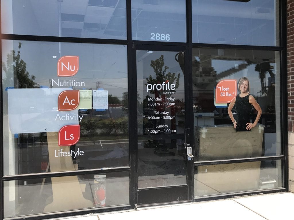 Profile Sanford Nutition Activity Lifestyle window  graphics vinyl store building front