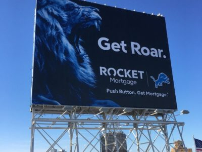 "Rocket Mortgage Detroit Lion Billboard ""get roar"" ""push button. get mortgage."" lions foot logo stadium promotional advertisement"