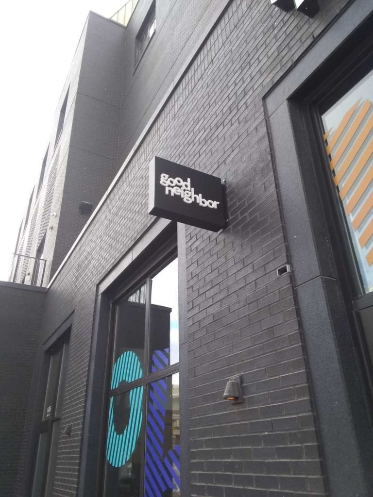 Good Neighbor Blade Sign downtown Detroit retail storefront signage dimensional letters
