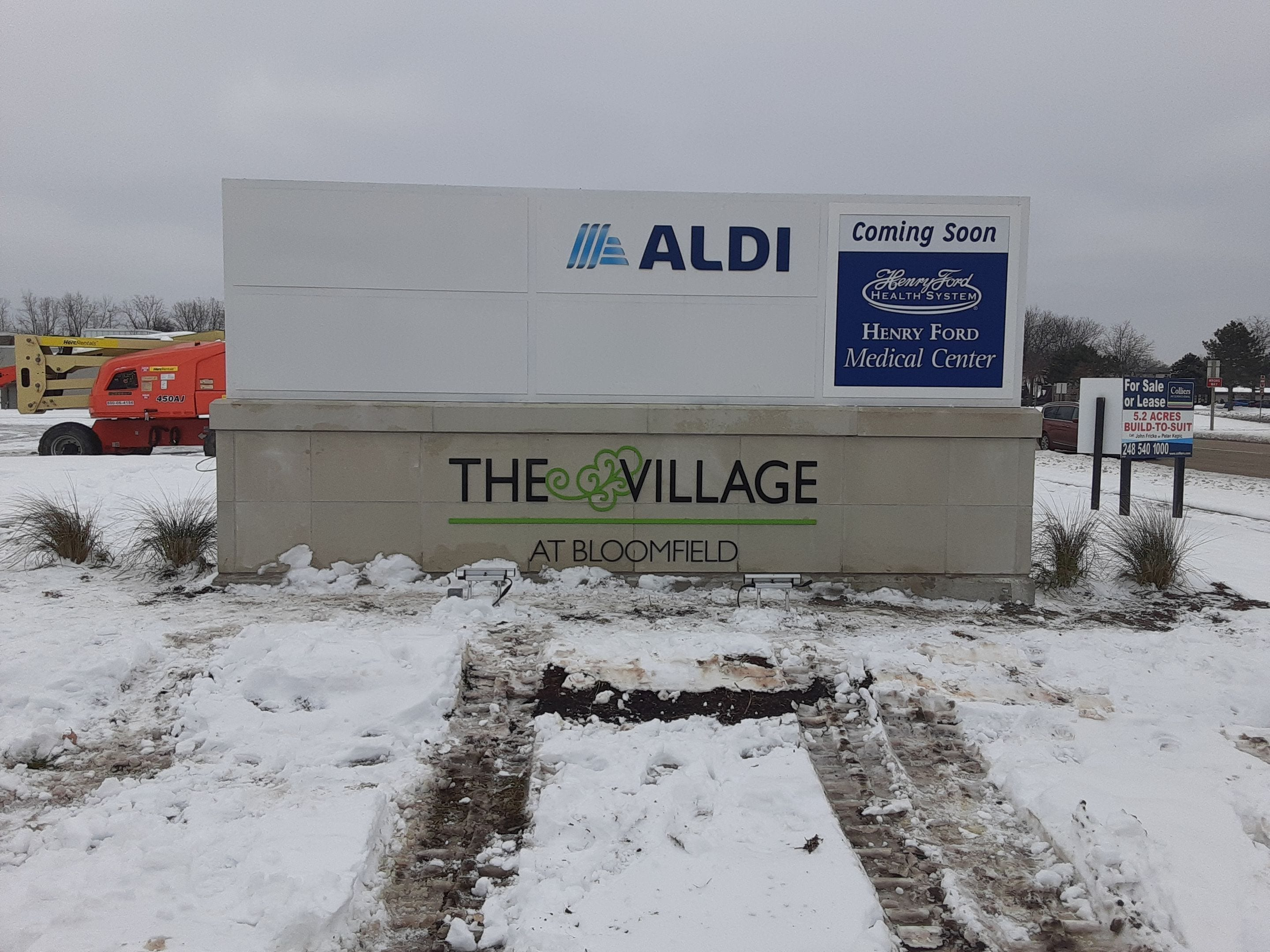 "The Village at Bloomfield Monument tenant panels Acrylic letters logo ""Aldi"" ""Coming Soon Henry Ford Medical Center"""