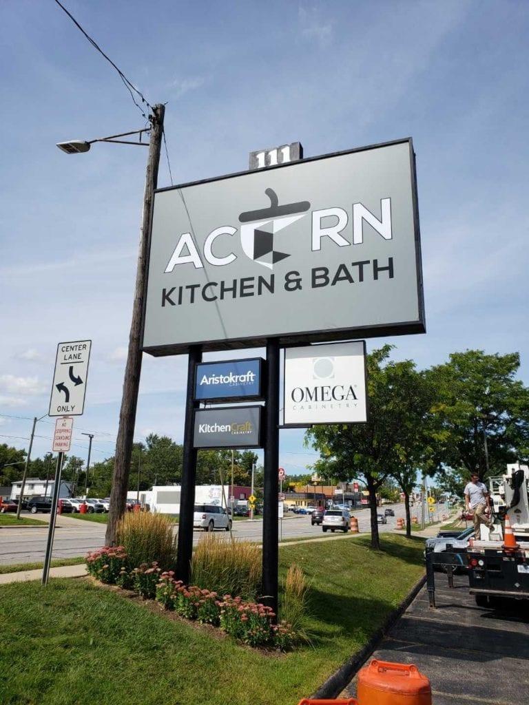 Acorn Kitchen and Bath Pylon double Pole roadside sign Multiple cabinet logo faces