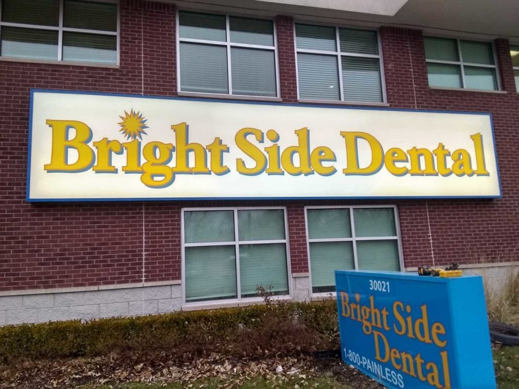 exterior wall sign cabinet face box signage Bright Side Dental illuminating detroit dentist
