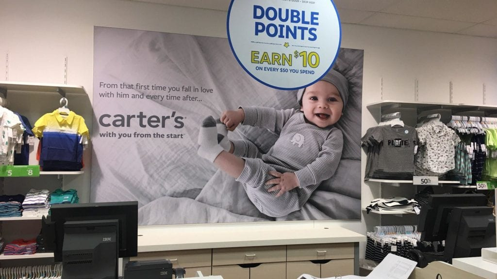 Carter's Store Promotional Banner Interior baby clothing retail sale sign