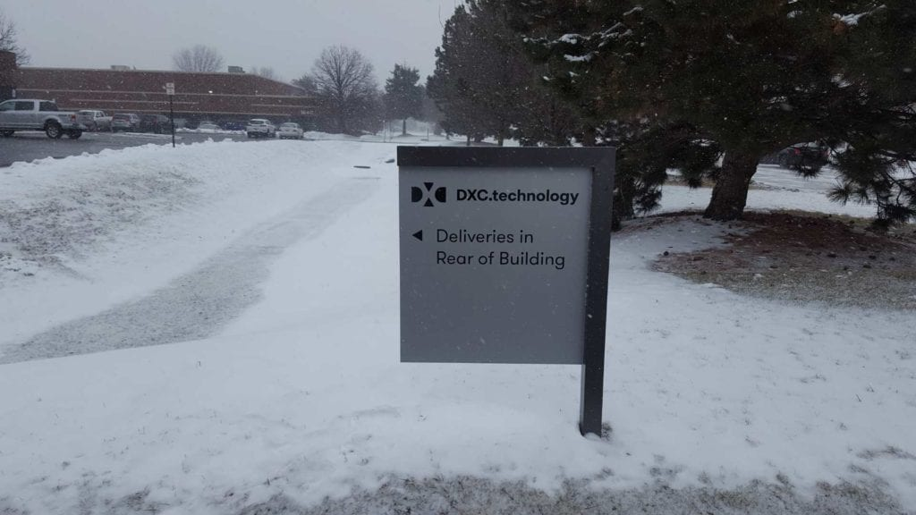 """DXC WAYFINDING Directional sign """"Deliveries in Rear of Building"""""""