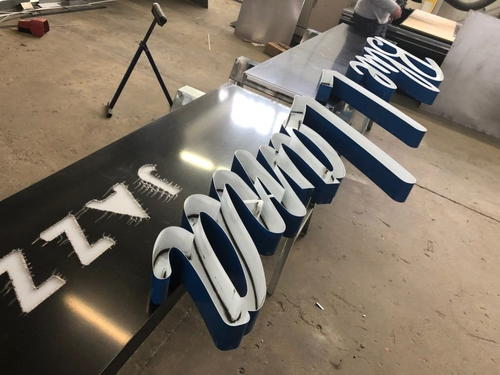 Manufacturing in shop of Blue Llama Sign, Downtown Grand Rapids