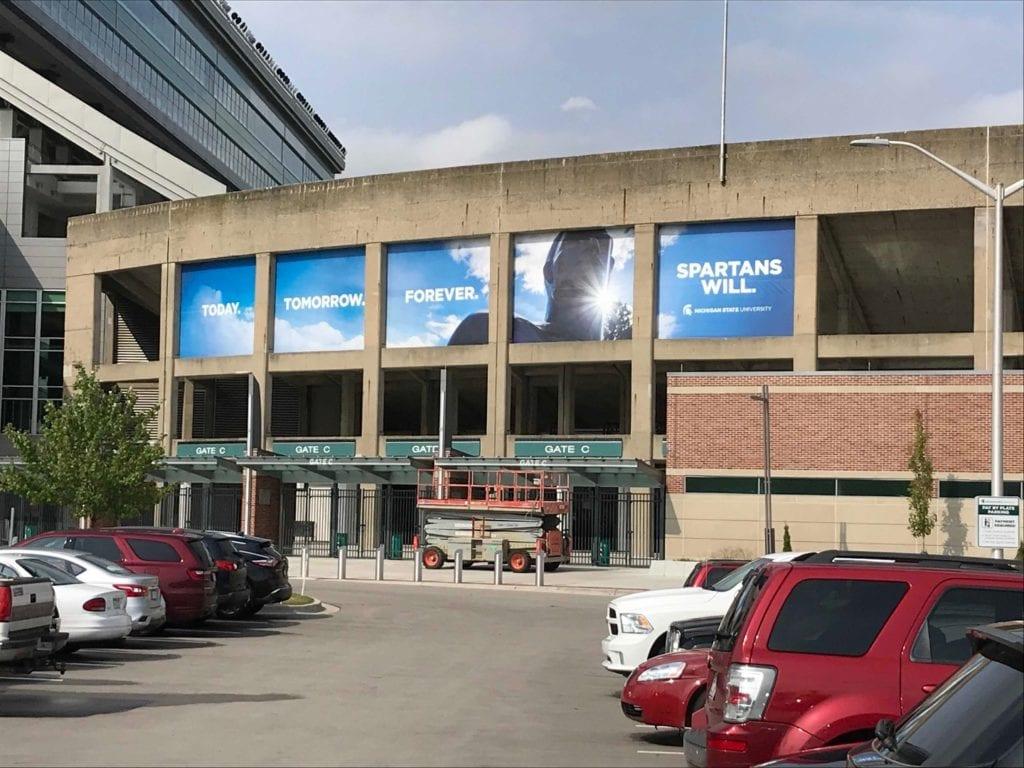 """MSU Parking Garage temporary graphics """"Spartan will."""""""