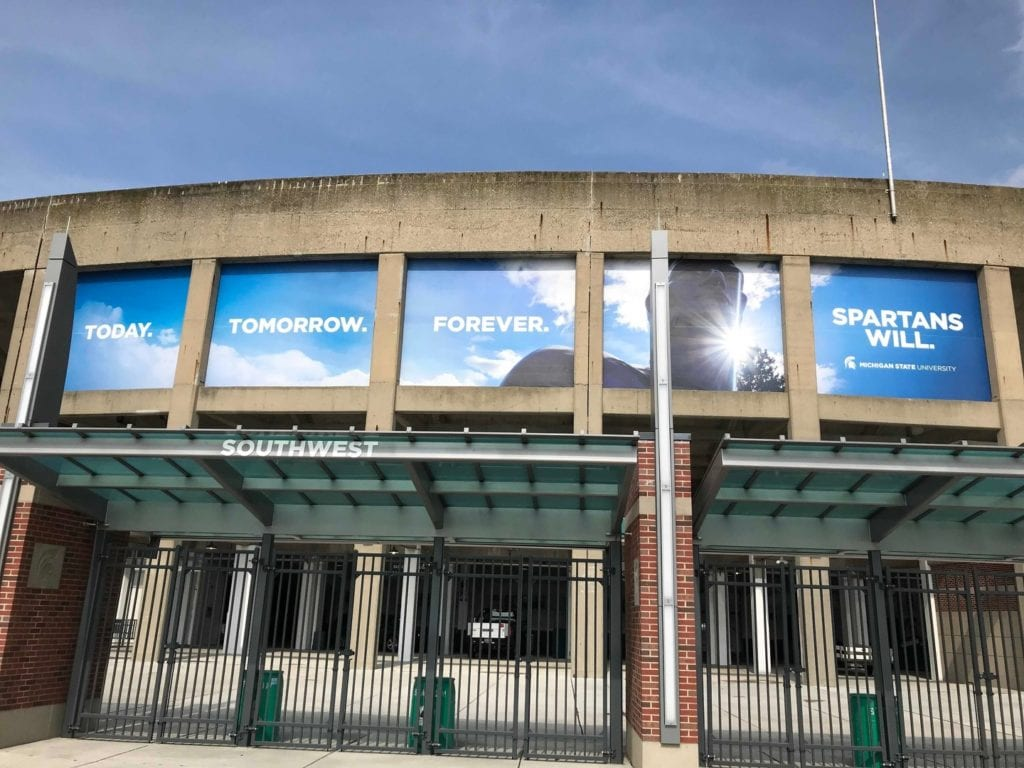"Spartan Banners Parking Garage ""Spartans will"" multiple banner graphics Lansing Michigan"
