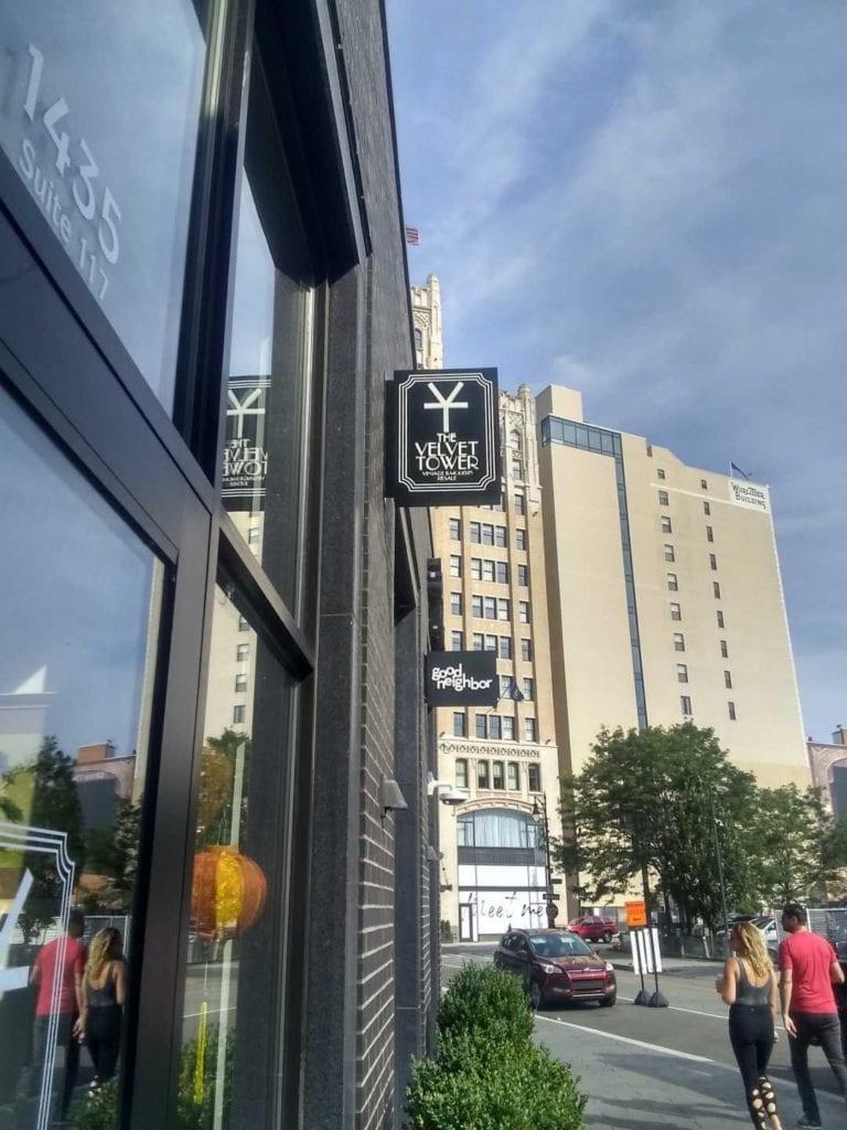 Illuinating Blade sign push thru Detroit Downtown