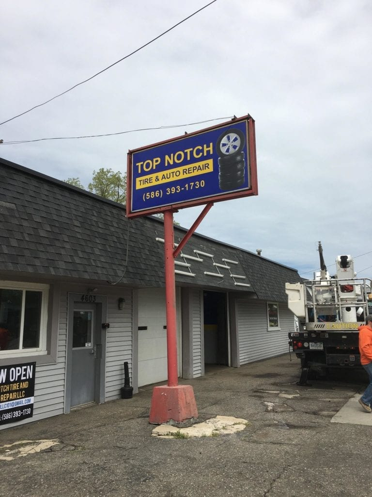 Pylon Pole Sign auto tire repair shop illuminating tires Top Notch
