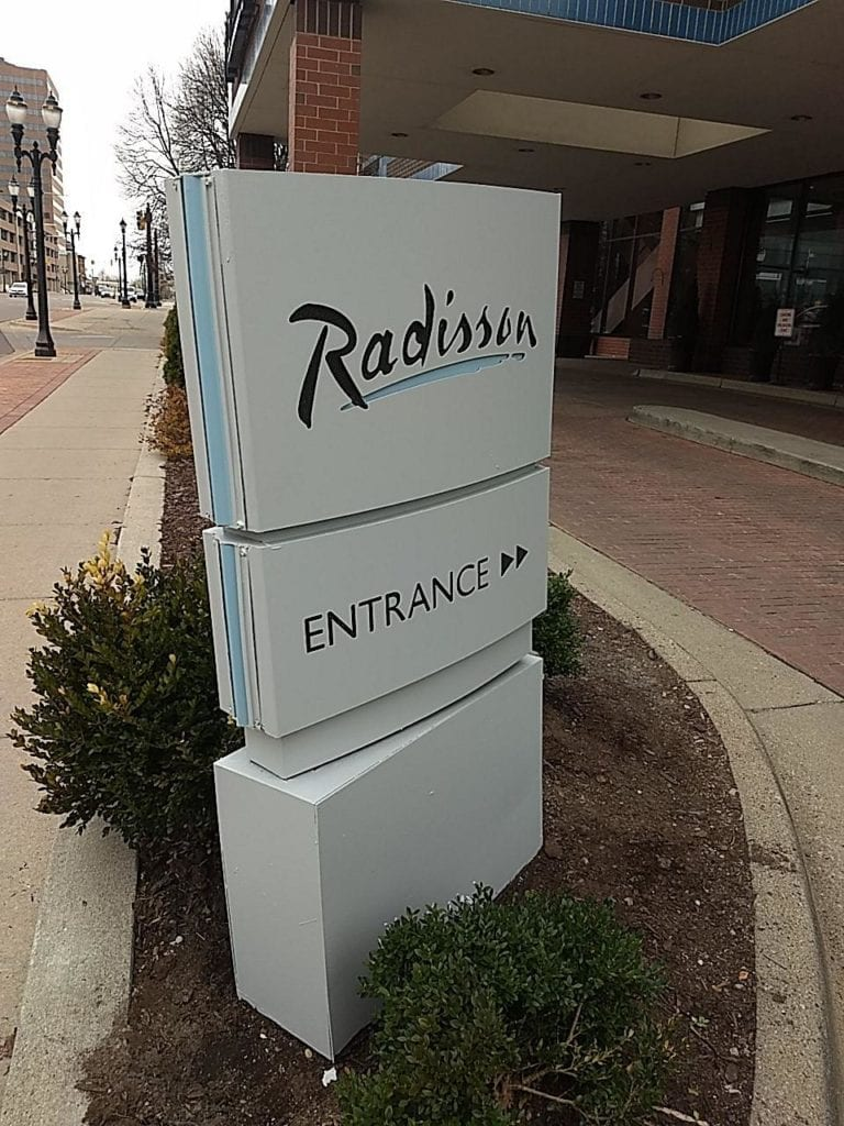 "Radisson Directional ""Entrance"" Sign with arrow"