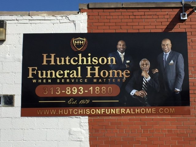 Hutchison Funeral Home Banner Detroit Brick wall side building roadside