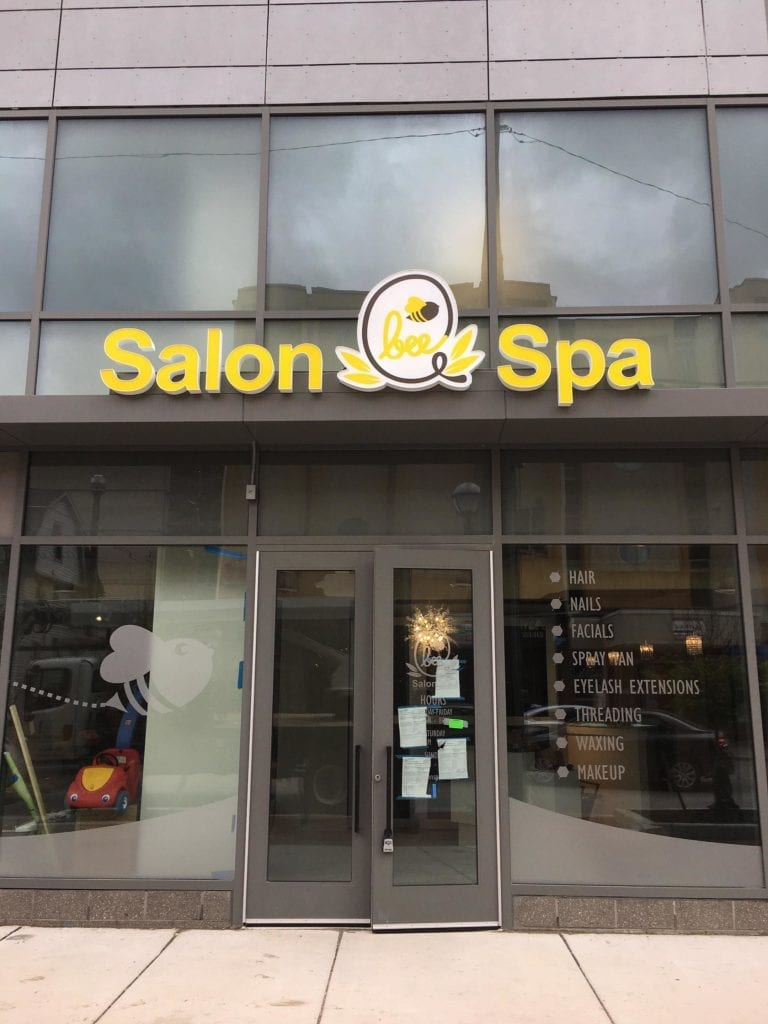 Bee Q Salon Spa building front logo bees window graphics Michigan branding