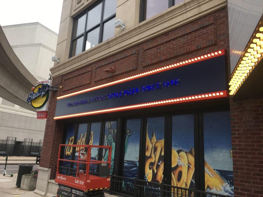 "Blue Neon lettering window graphics bulbs ""orginal detroit style pizza since 1946"" sign Buddy's Pizza Detroit"