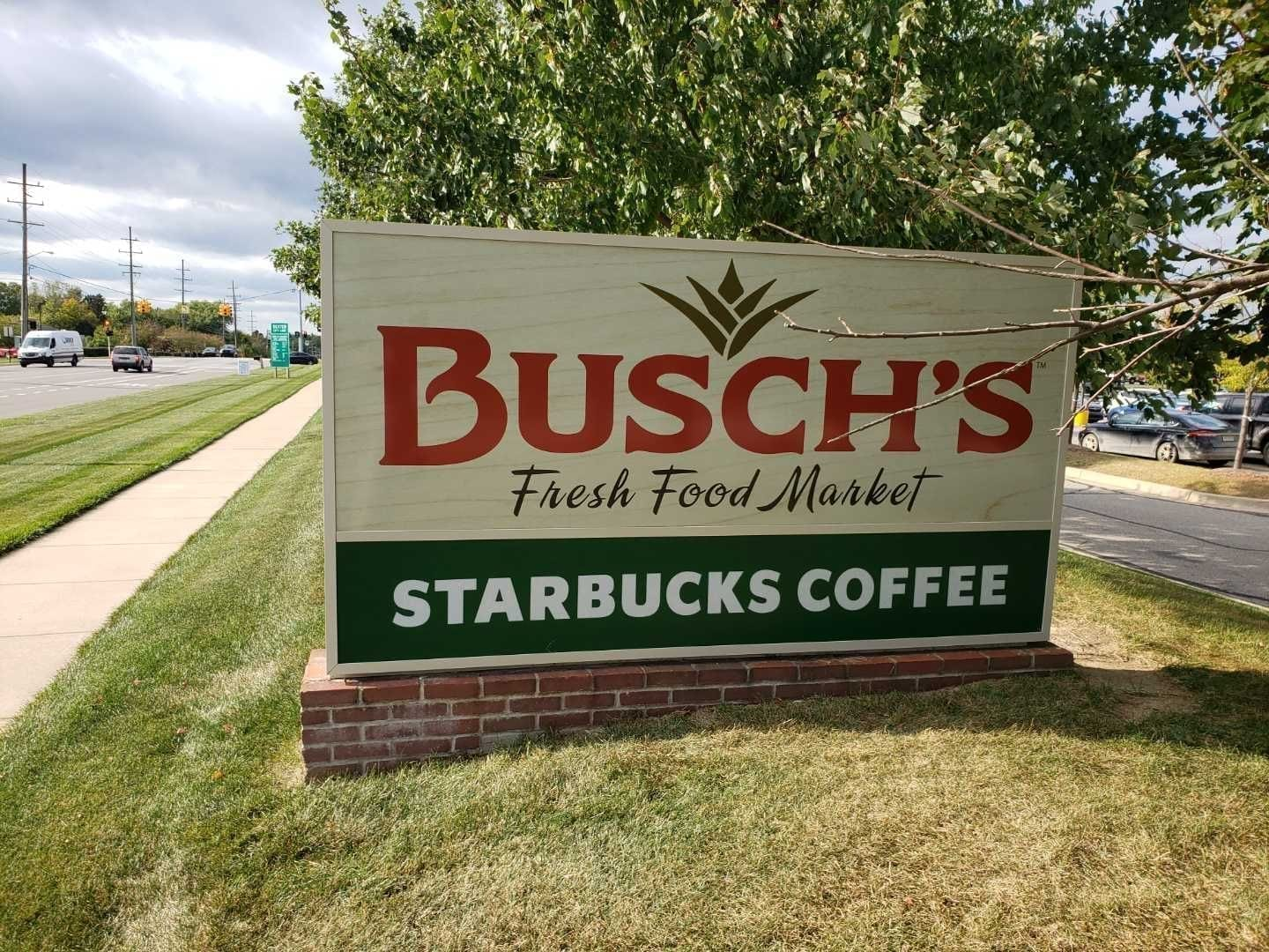 Busch's Fresh Food Market monument sign tenant panels Starbucks Coffee