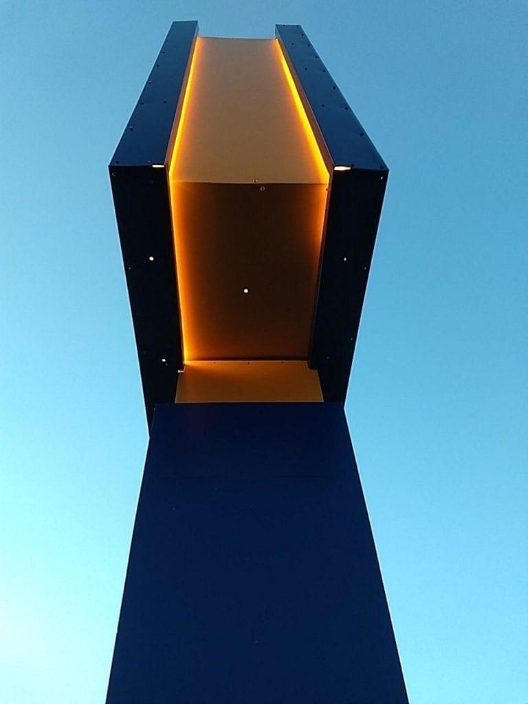 Comfort Inn Pylon Sign Lighting - orange and blue halo lit - side view