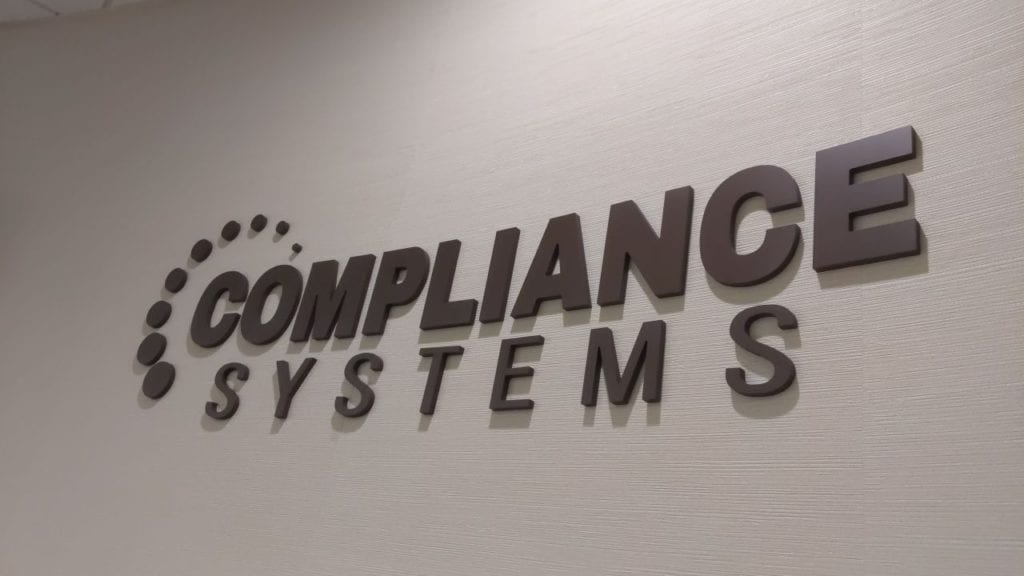 compliance systems custom interior sign letters  and logo router cut bronze wall mounted