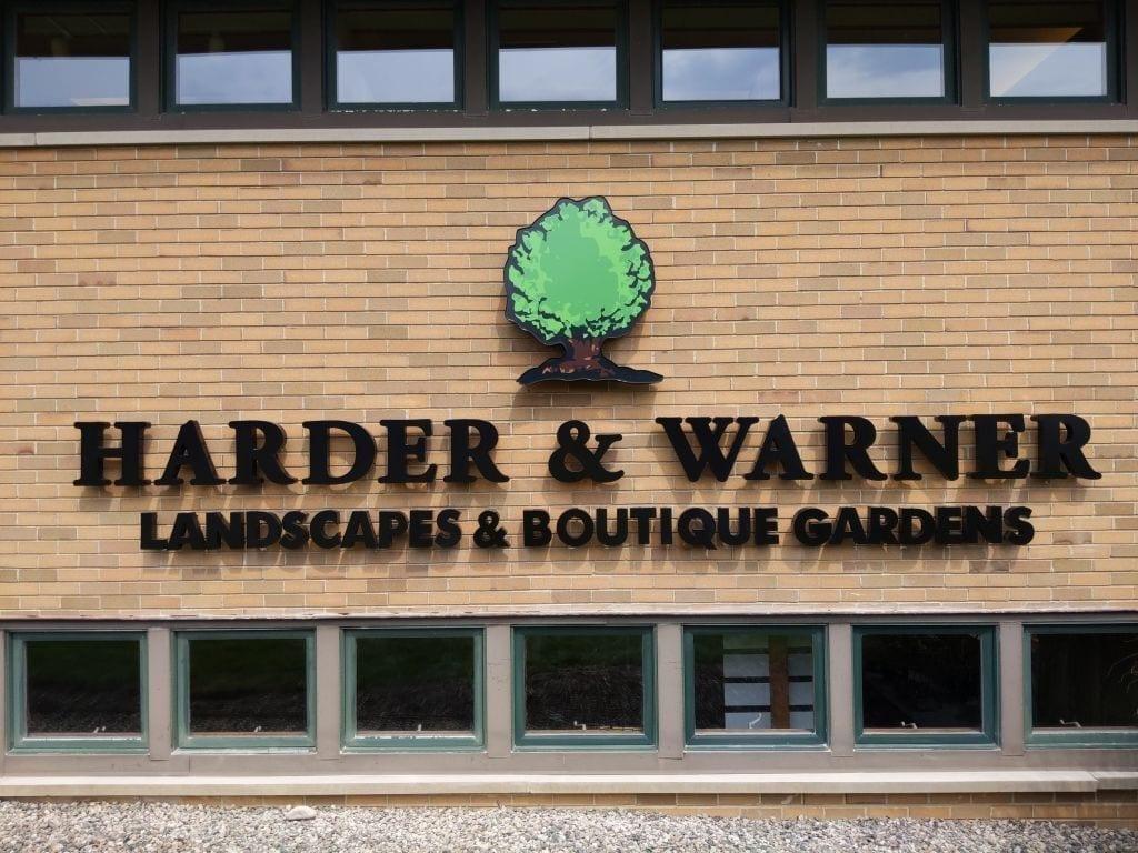 Channel letter building sign on Harder & Warner - Landscapes & Boutique Gardens