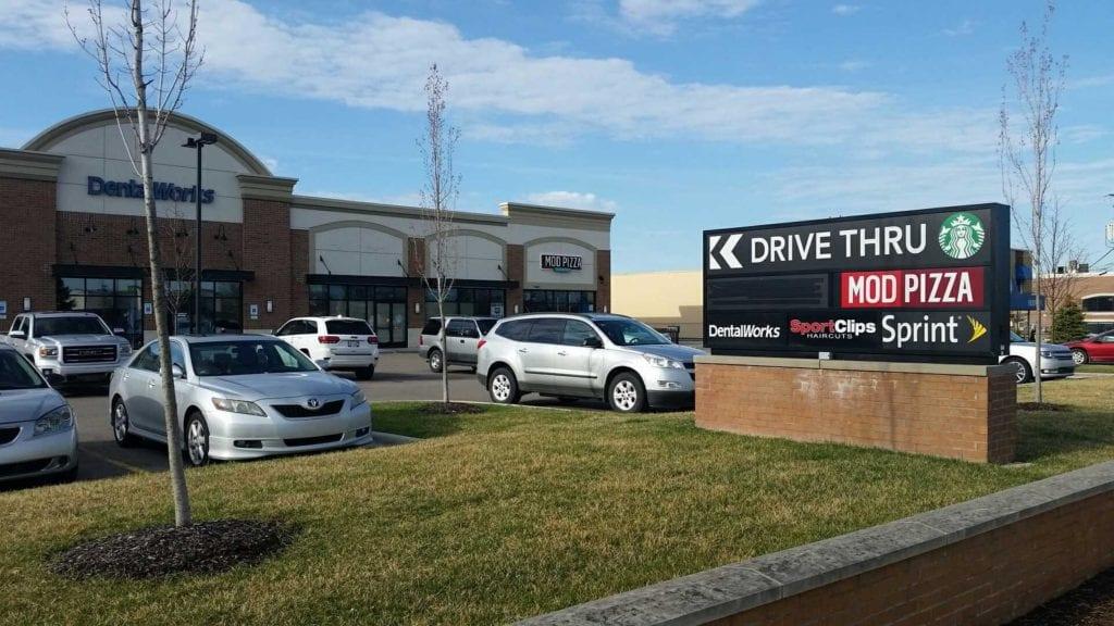 Starbucks Drive Thru- Plaza signage panels tenant inserts
