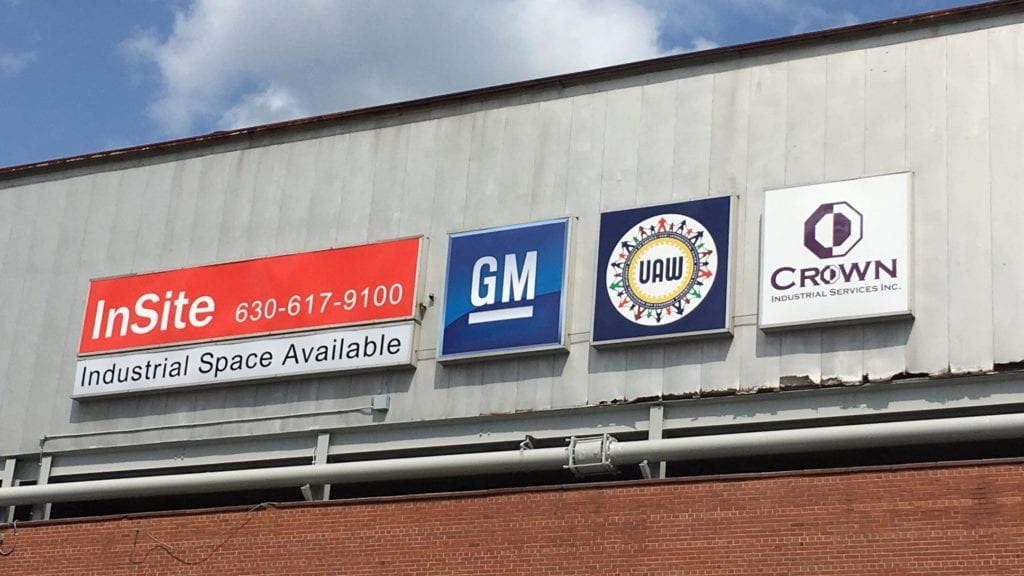 GM UAW CROWN logo box signs industrial storefront illuminating