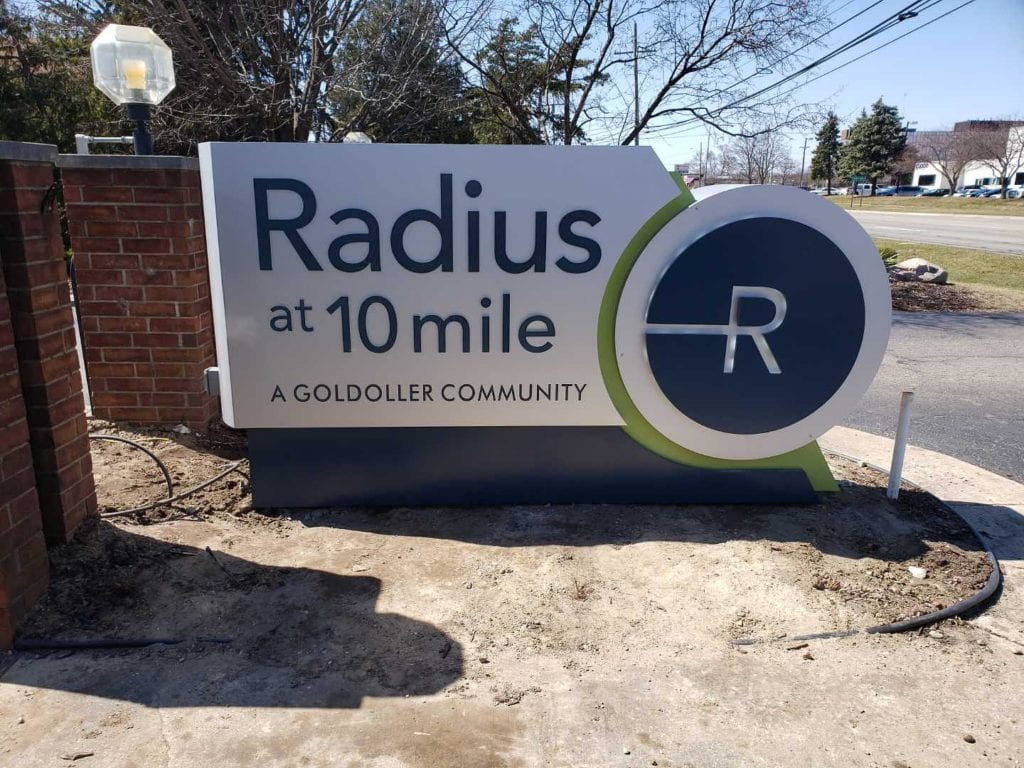 "Radius at 10 mile community monument sign custom fabricated shaped aluminum dimensional logo residential signage ""a Goldoller community"""