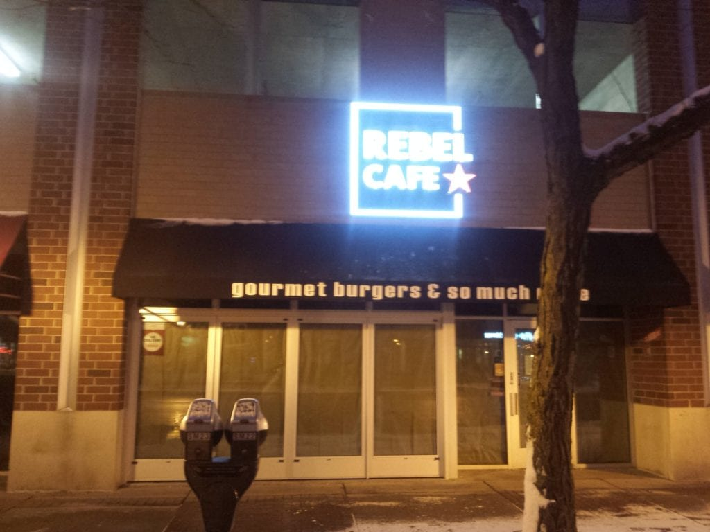Illuminating front and back lit store sign  for Rebel Cafe