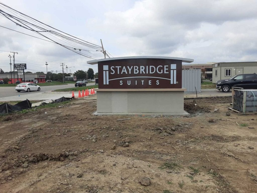 Staybridge Suites monument sign custom shaped topper stone base roadside hotel signage