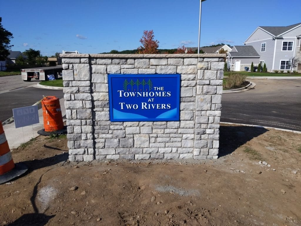 the townhouse and two rivers  Monument sign custom masonry stone cabinet digital printed face residential signage