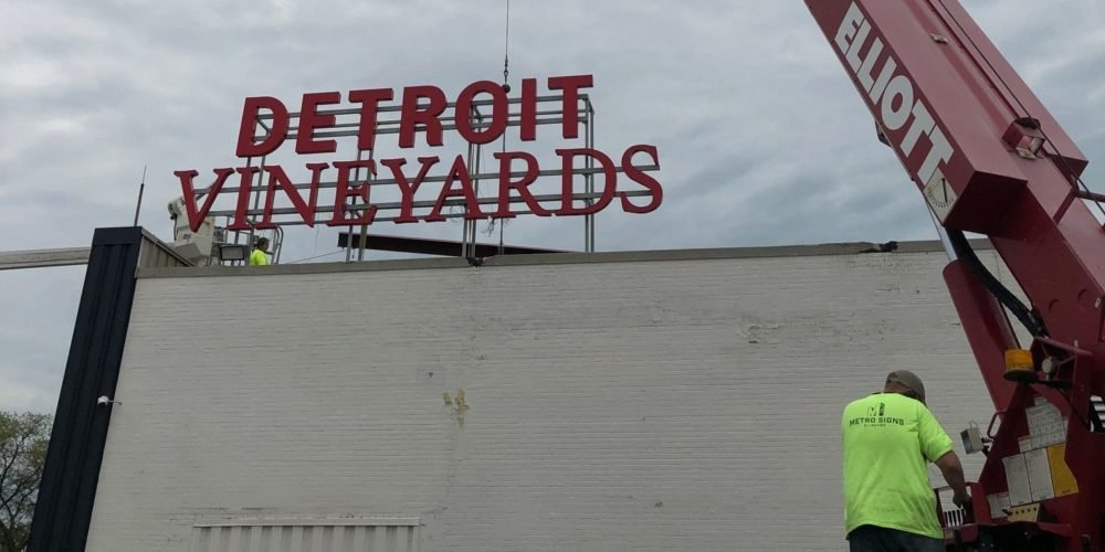 Detroit Vineyards Channel Letter sign installation with crane