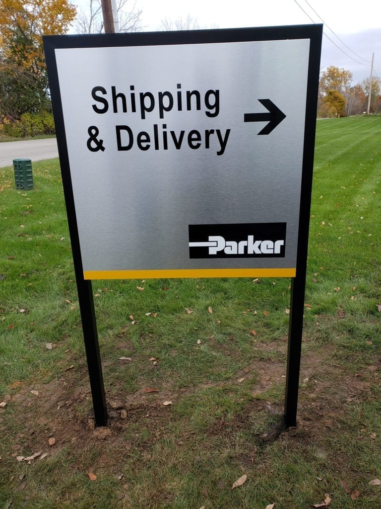 Parker_ directional signs Shipping and delivery arrow polishe brushed aluminum panel with cut vinyl graphics logo
