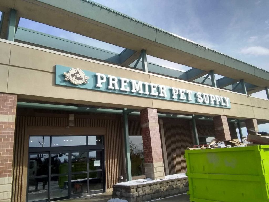Premiere Pet supply exterior storefront letters beverly hills MI backer acrylic halo lit back lit custom fabricated logo white alumiinum day view