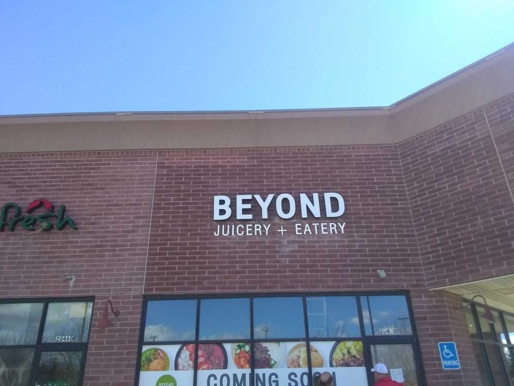 beyond juicery - eatery dimensional white aluminum exterior letters sign storefront brick building