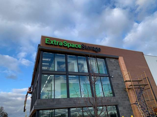 Extra Space Storage exterior channel letter sign - green and black