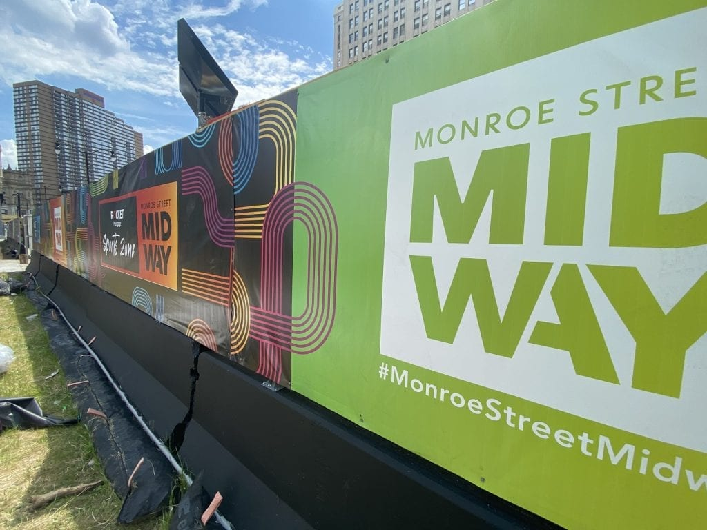 Monroe Street Midway Banners on Fencing - orange, green, pink, blue, yellow design